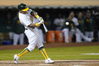 Oakland Athletics' Khris Davis hits an RBI-double against the Seattle Mariners during the third inning of a baseball game in Oakland, Calif., Monday, Sept. 20, 2021. (AP Photo/Jeff Chiu)