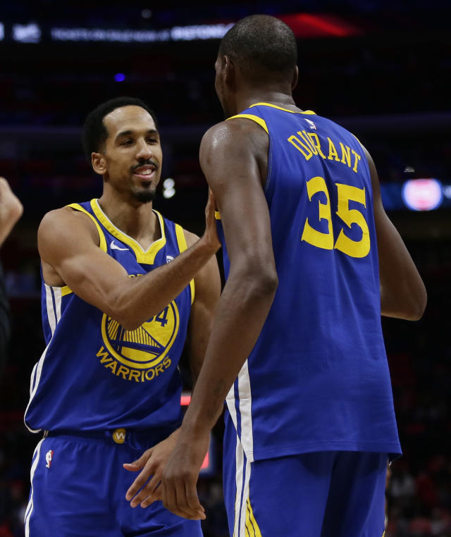 Golden State Warriors guard Shaun Livingston (34) smiles as he congratulates forward Kevin Durant (35) after the team's 102-98 win over the Detroit Pistons in an NBA basketball game Friday, Dec. 8, 2017, in Detroit. (AP Photo/Duane Burleson)