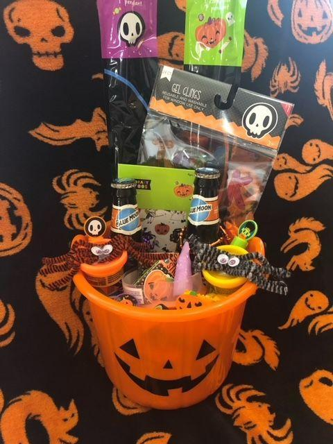 """<p>We've already mentioned that this tradition isn't just for kids. Add some Blue Moon pumpkin beer and <a href=""""https://go.redirectingat.com?id=74968X1596630&url=https%3A%2F%2Fwww.orientaltrading.com%2Fgothic-halloween-ruby-shot-glasses-a2-13837075.fltr%3FcategoryId%3D551213%2B1237&sref=https%3A%2F%2Fwww.goodhousekeeping.com%2Fholidays%2Fhalloween-ideas%2Fg34288815%2Fspooky-basket-ideas%2F"""" rel=""""nofollow noopener"""" target=""""_blank"""" data-ylk=""""slk:skull shot glasses"""" class=""""link rapid-noclick-resp"""">skull shot glasses</a> and you've got a gift basket good for Halloween after hours. </p><p><a href=""""https://gracebeautyandfbombs.com/boobaskets/"""" rel=""""nofollow noopener"""" target=""""_blank"""" data-ylk=""""slk:See more at Grace Beauty and F Bombs »"""" class=""""link rapid-noclick-resp""""><em>See more at Grace Beauty and F Bombs »</em></a></p>"""