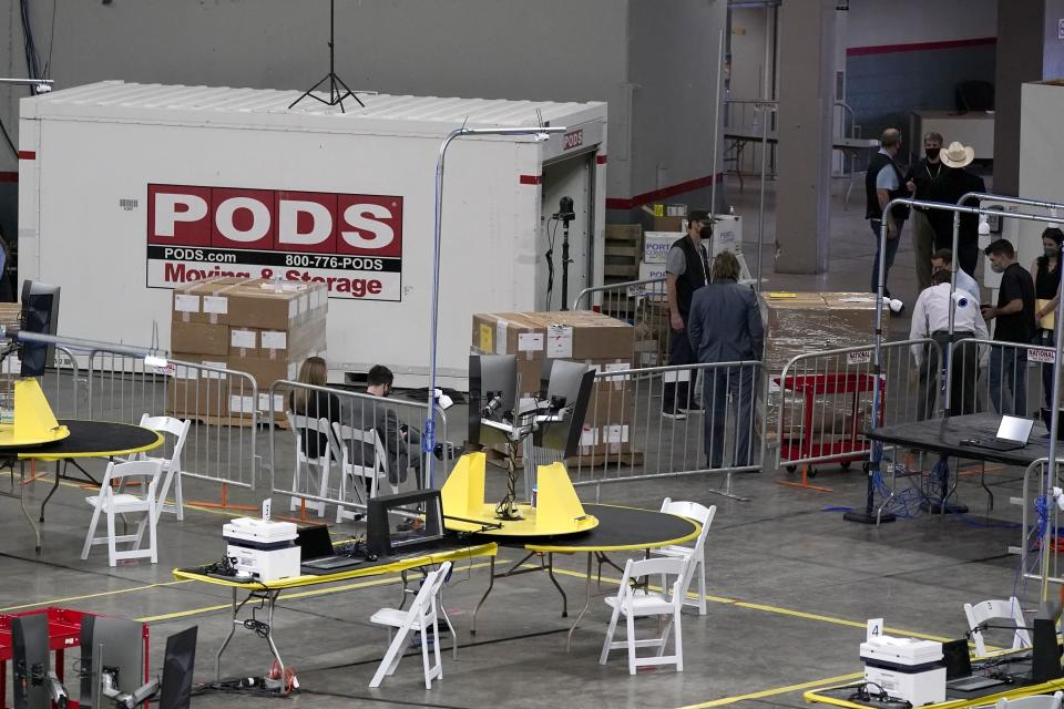 Some of the 2.1 million ballots cast during the 2020 election, are brought in for recounting at a 2020 election ballot audit ordered by the Republican lead Arizona Senate at the Arizona Veterans Memorial Coliseum, during a news conference Thursday, April 22, 2021, in Phoenix. The equipment used in the November election won by President Joe Biden and the 2.1 million ballots were moved to the site Thursday so Republicans in the state Senate who have expressed uncertainty that Biden's victory was legitimate can recount them and audit the results. (AP Photo/Ross D. Franklin)