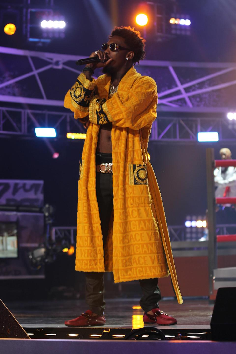 Offset performs with Migos at the BET Hip Hop Awards in Atlanta, September 20, 2014.
