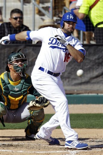 Los Angeles Dodgers' Andre Ethier (16) doubles down the first base line to drive in two runs in the fourth inning of a spring training baseball game against the Oakland Athletics, Thursday, March 8, 2012, in Glendale, Ariz. (AP Photo/Mark Duncan)