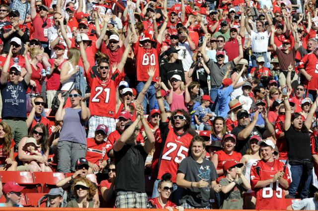 Calgary Stampeders' fans celebrate a touchdown against the Montreal Alouettes during first half CFL acton in Calgary on Friday July 1st, 2011. CFL PHOTO-Larry MacDougal