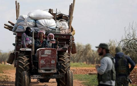 Residents of the town of Inab, eastern Afrin, Syria, flee a Turkey-backed rebel offensive - Credit: Reuters