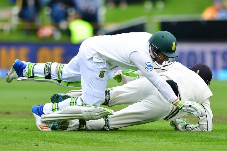 South Africa's Dean Elgar (front) runs into New Zealand's keeper BJ Watling during day four of the first international cricket test in Dunedin