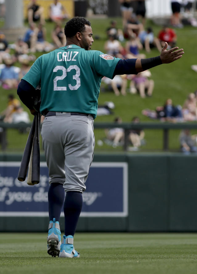Seattle Mariners designated hitter Nelson Cruz gestures as he leaves during the first inning of a spring training baseball game against the Colorado Rockies in Scottsdale, Ariz., Tuesday, March 13, 2018. (AP Photo/Chris Carlson)