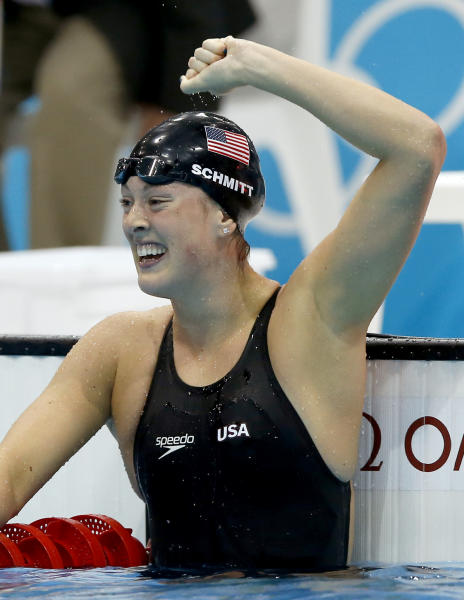 United States' Allison Schmitt celebrates her gold medal win in the women's 200-meter freestyle swimming final at the Aquatics Centre in the Olympic Park during the 2012 Summer Olympics in London, Tuesday, July 31, 2012. (AP Photo/Daniel Ochoa De Olza)