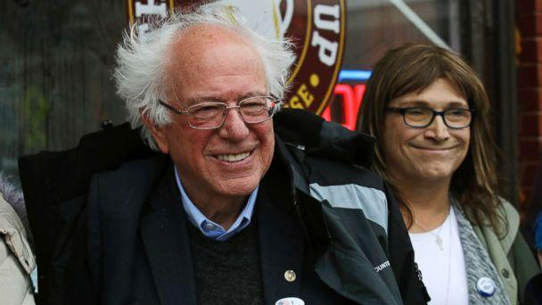 PHOTO: Sen. Bernie Sanders smiles as he poses for a photograph with Vermont Democratic gubernatorial candidate Christine Hallquist outside City Hall in Saint Albans, Vt., Nov. 6, 2018. (Charles Krupa/AP)