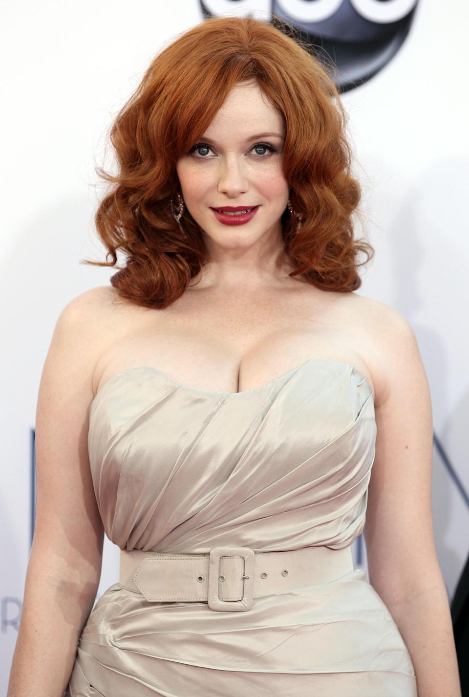 """Christina Hendricks from """"Mad Men"""" arrives at the 64th Primetime Emmy Awards at the Nokia Theatre on Sunday, Sept. 23, 2012, in Los Angeles. (Photo by Matt Sayles/Invision/AP)"""