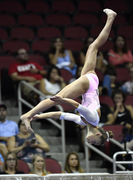 Grace McCallum performs her routine on the balance beam during the GK US Classic gymnastics meet in Louisville, Ky., Saturday, July 20, 2019. (AP Photo/Timothy D. Easley)
