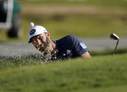 Dustin Johnson hits out of the green side bunker on the 16th hole during the first round of the Genesis Invitational golf tournament at Riviera Country Club, Thursday, Feb. 18, 2021, in the Pacific Palisades area of Los Angeles. (AP Photo/Ryan Kang)