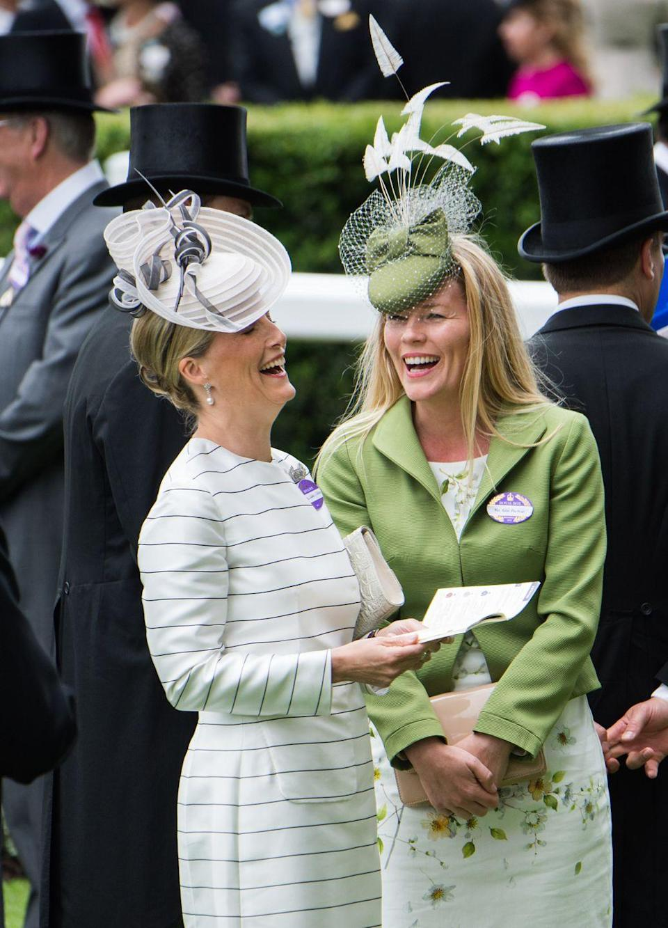 <p>Here, Sophie shares a laugh with Autumn Phillips at the Royal Ascot. As is required at the annual horse-racing event, she paired her striped dress with a stylish topper.</p>