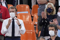 French President Emmanuel Macron, left, and United States First Lady Jill Biden, right, applaud as they watch a women's 3-on-3 basketball game between the United States and France at the 2020 Summer Olympics, Saturday, July 24, 2021, in Tokyo, Japan. (AP Photo/Jeff Roberson)