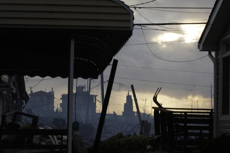 Damage caused by a fire at Breezy Point is shown Tuesday, Oct. 30, 2012, in the aftermath of superstorm Sandy, in the New York City borough of Queens. The fire destroyed between 80 and 100 houses Monday night in the flooded neighborhood. (AP Photo/Frank Franklin II)