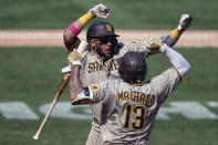 San Diego Padres' Fernando Tatis Jr celebrates after hitting a solo home run against the Oakland Athletics with teammate Manny Machado during the seventh inning of a baseball game in Oakland, Calif., Sunday, Sept. 6, 2020. (AP Photo/Jed Jacobsohn)