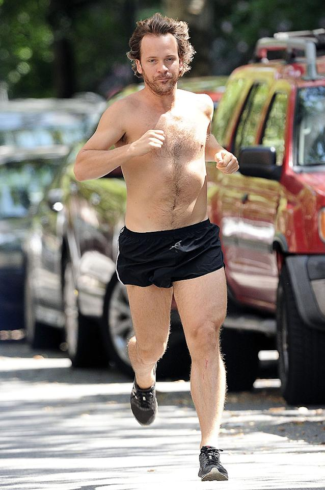 When it's a hot and humid summer day in New York City and you want to  get your daily run in, what do you? Strip down! Actor Peter Sarsgaard  donned some short shorts and not much else when he hit the pavement for a  little exercise over the weekend. (8/26/2012)