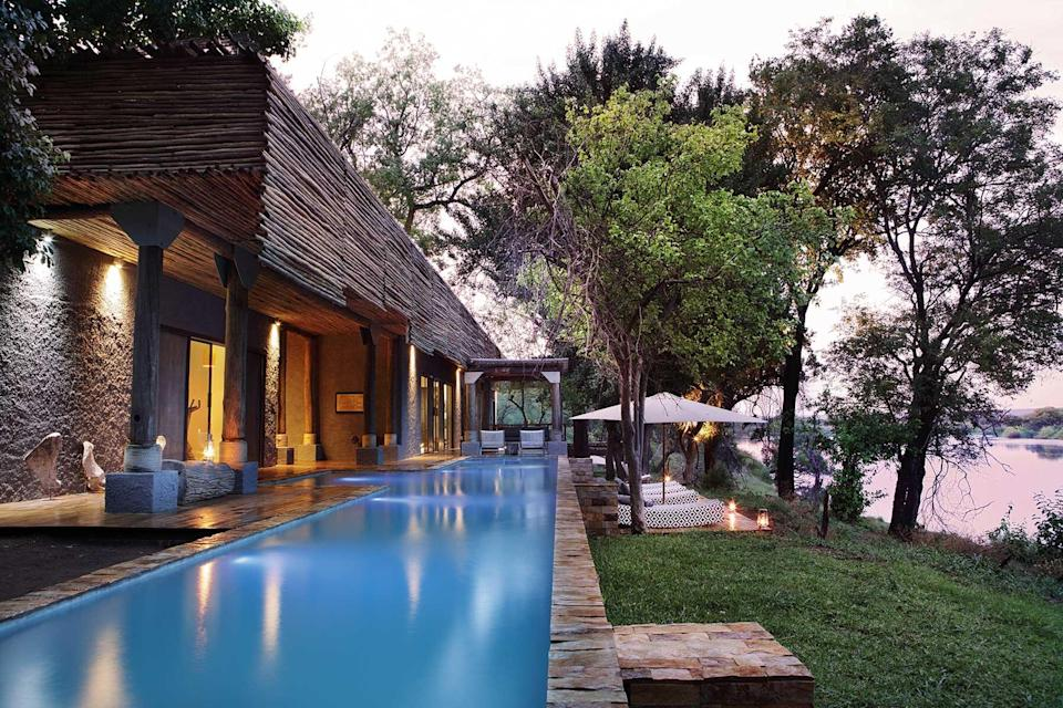 Exterior and pool of the Matetsi Victoria Lodge, voted one of the best hotels in the world