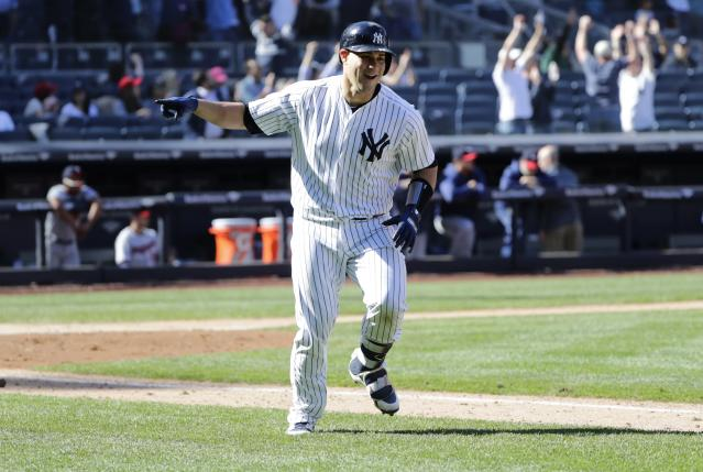 New York Yankees' Gary Sanchez celebrates after hitting the game winning three-run home run against the Minnesota Twins during the ninth inning of a baseball game against the Minnesota Twins Thursday, April 26, 2018, in New York. The Yankees won 4-3. (AP Photo/Frank Franklin II)