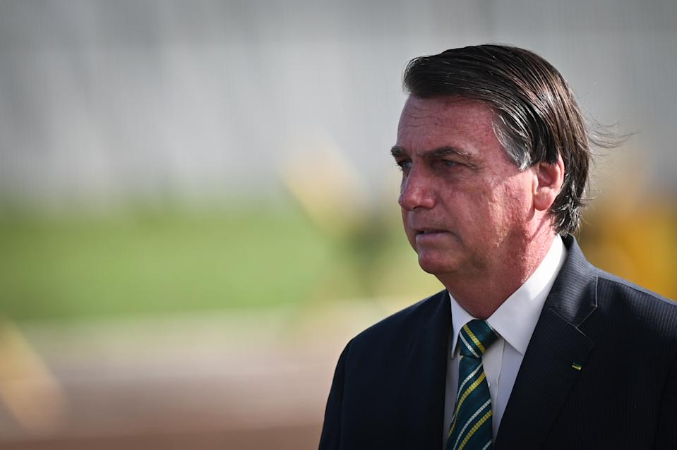 Brazil's president Jair Bolsonaro arrives to attend the National Flag Raising ceremony in front of Alvorada Palace amid the Coronavirus (COVID-19) pandemic, in Brasilia, Brazil, on Tuesday, October 27, 2020. (Photo by Andre Borges/NurPhoto via Getty Images)