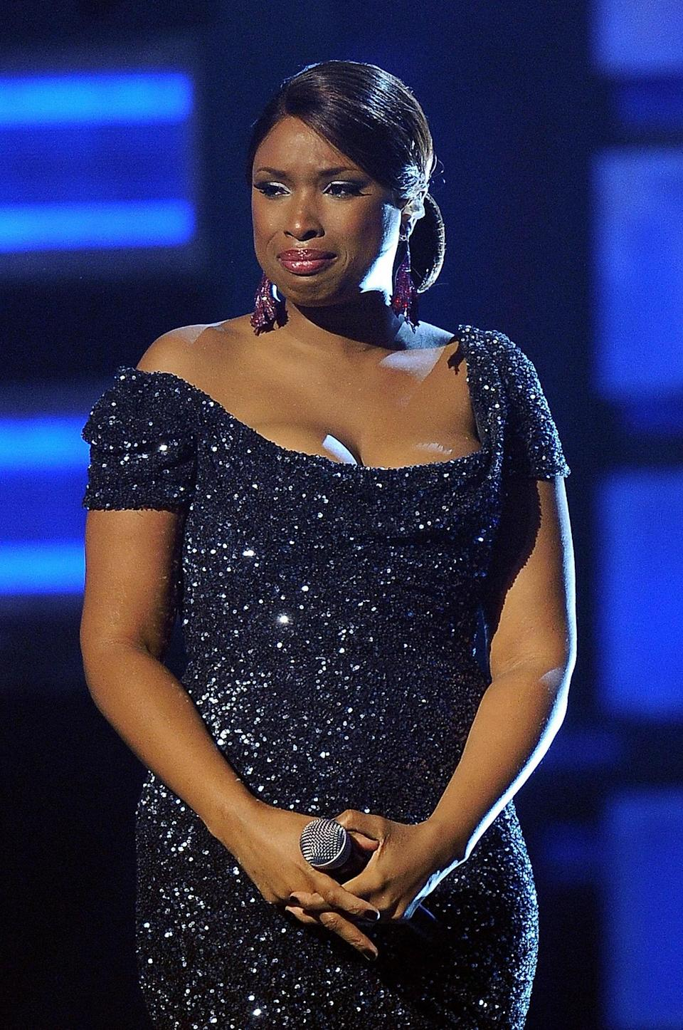 "Our hearts broke for <a href=""http://www.glamour.com/about/jennifer-hudson?mbid=synd_yahoo_rss"" rel=""nofollow noopener"" target=""_blank"" data-ylk=""slk:Jennifer Hudson"" class=""link rapid-noclick-resp"">Jennifer Hudson</a> when she suffered the tragic deaths of her mother, brother and young nephew in fall 2008. So when she appeared on the stage during the 2009 show—her first major appearance after the horrific ordeal—our eyes immediately welled up. Backed by a choir, J-Hud delivered a flawless performance of her hit ""You Pulled Me Through"" breaking down into tears while delivering the final words."