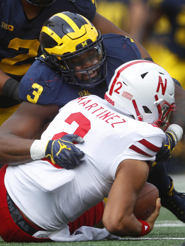 Michigan defensive lineman Rashan Gary (3) sacks Nebraska quarterback Adrian Martinez (2) in the first half of an NCAA football game in Ann Arbor, Mich., Saturday, Sept. 22, 2018. (AP Photo/Paul Sancya)