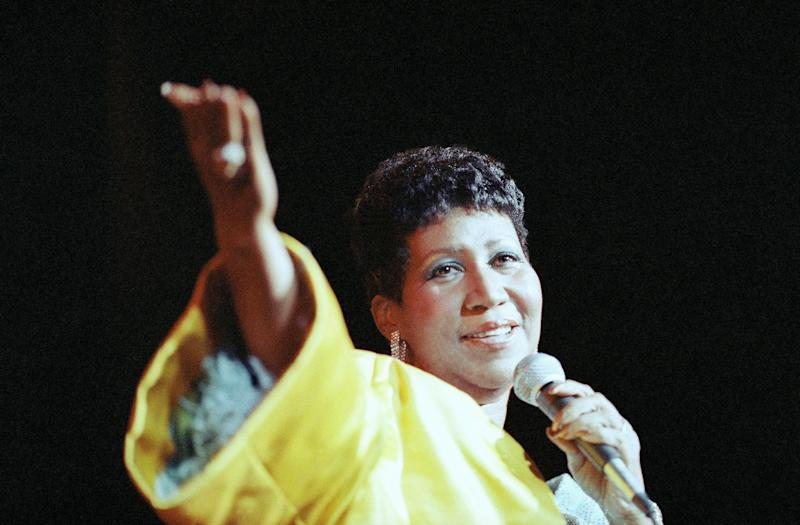 """Among Aretha Franklin's most famous hits was her signature song, """"Respect,"""" which became a rallying cry for women as well as for black empowerment. She's seen here performing at New York's Radio City Music Hall in 1989. (Photo: Mario Suriani/AP)"""