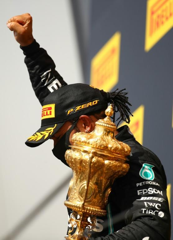 Lewis Hamilton makes a clenched fist protest on the podium