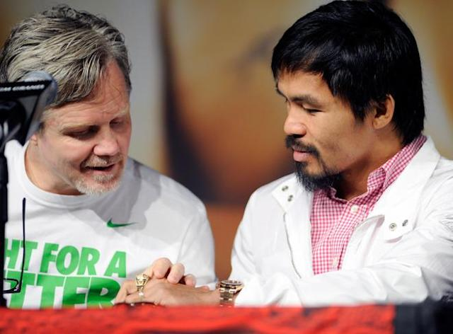 LAS VEGAS, NV - JUNE 06: Trainer, Freddie Roach (L) admires boxer Manny Pacquiao's new ring during the final news conference for Pacquiao's bout with Timothy Bradley at the MGM Grand Hotel/Casino June 6, 2012 in Las Vegas, Nevada. Pacquiao will defend his WBO welterweight title against Bradley when the two meet in the ring on June 9 in Las Vegas. (Photo by David Becker/Getty Images)