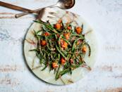 """This kicky sauce, inspired by Spanish romesco, uses cherry tomatoes. <a href=""""https://www.bonappetit.com/recipe/blistered-green-beans-with-tomato-almond-pesto?mbid=synd_yahoo_rss"""" rel=""""nofollow noopener"""" target=""""_blank"""" data-ylk=""""slk:See recipe."""" class=""""link rapid-noclick-resp"""">See recipe.</a>"""