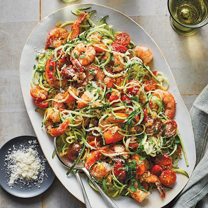"""<p>Enjoy classic shrimp scampi lightened up with a white wine-butter sauce and zucchini noodles in place of pasta. The tomatoes add some sweetness and color, while the cheese contributes nuttiness and richness.</p> <p> <a href=""""http://www.eatingwell.com/recipe/278407/easy-shrimp-scampi-with-zucchini-noodles/"""" rel=""""nofollow noopener"""" target=""""_blank"""" data-ylk=""""slk:View recipe"""" class=""""link rapid-noclick-resp""""> View recipe </a></p>"""