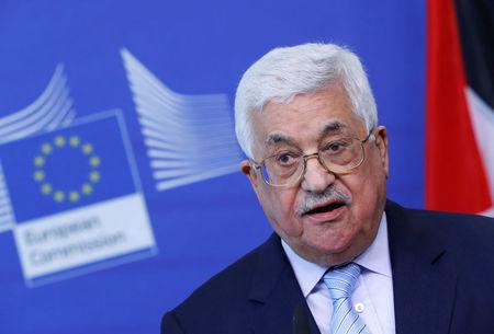Palestinian President Mahmoud Abbas holds a news conference after a meeting with European Union foreign policy chief Federica Mogherini in Brussels