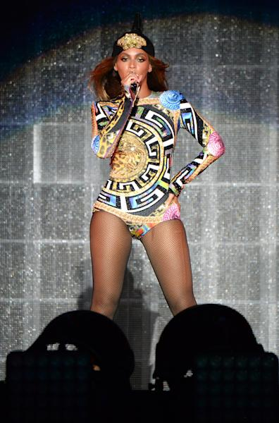 The singer's stage outfits also included a multicolored leotard featuring a huge Versace logo.
