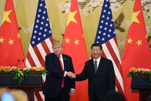 <p>U.S. President Donald Trump, left, and Chinese President Xi Jinping hold their joint press conference at the Great Hall of the People in Beijing, Thursday, Nov. 9, 2017. (AP Photo/Andrew Harnik) </p>