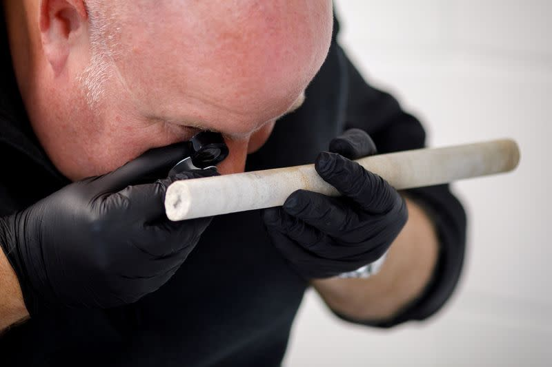 Researcher David Nash of the University of Brighton analyzes a stone core sample extracted from from Stonehenge monument