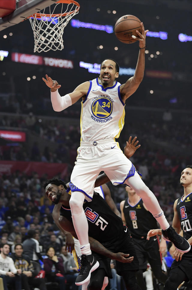 FILE - In this April 26, 2019, file photo, Golden State Warriors guard Shaun Livingston, top, shoots as Los Angeles Clippers guard Patrick Beverley, left, defends during the first half in Game 6 of a first-round NBA basketball playoff series in Los Angeles. Livingston announced his retirement Friday, Sept. 13, 2019, following 15 NBA seasons, an expected move. (AP Photo/Mark J. Terrill, File)