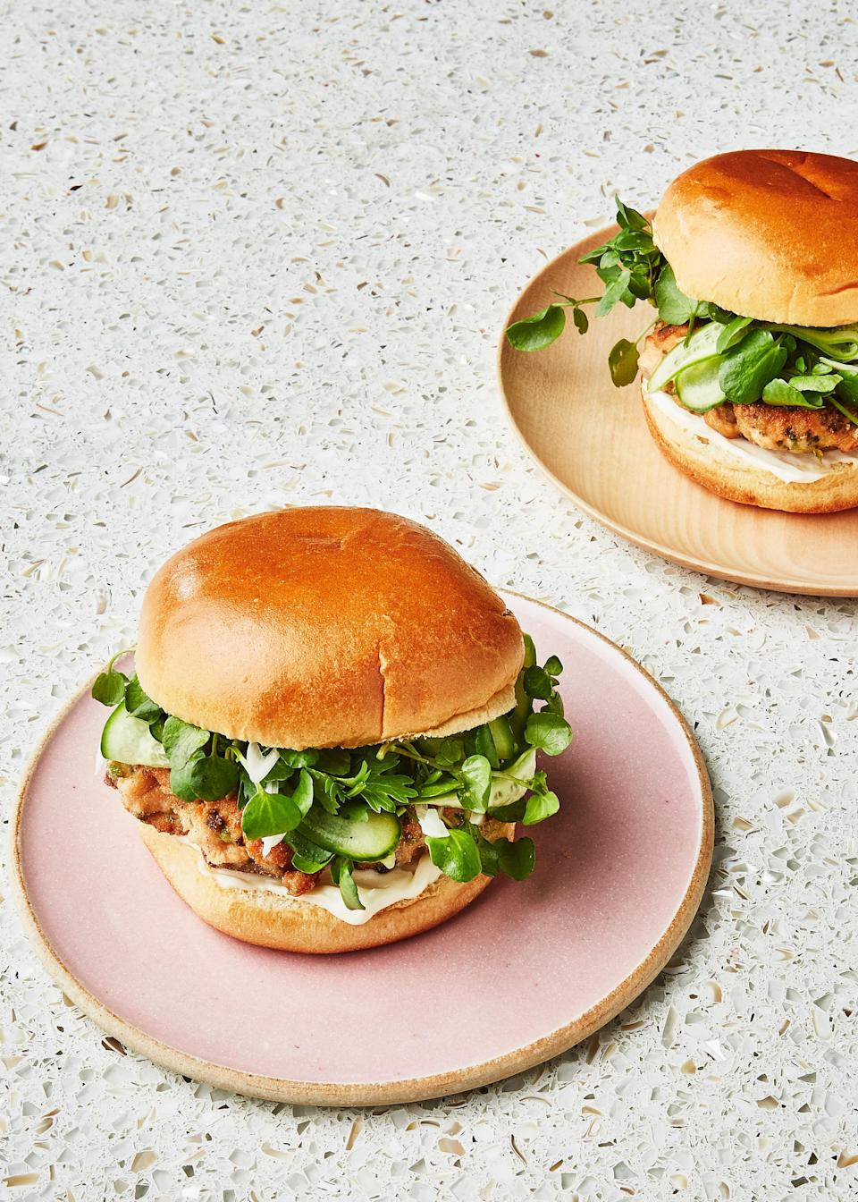 "The food processor is your friend when making these salmon burgers, but the key is to make sure the salmon isn't too smooth when processing so the patties can hold their shape. <a href=""https://www.bonappetit.com/recipe/salmon-burgers-with-pickled-cucumbers-and-watercress?mbid=synd_yahoo_rss"" rel=""nofollow noopener"" target=""_blank"" data-ylk=""slk:See recipe."" class=""link rapid-noclick-resp"">See recipe.</a>"