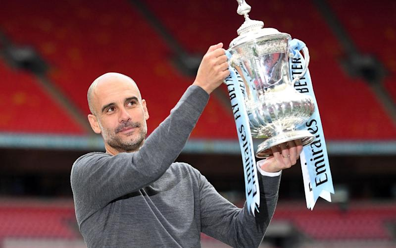 Pep Guardiola became the first manager to win a domestic treble in England - AFP