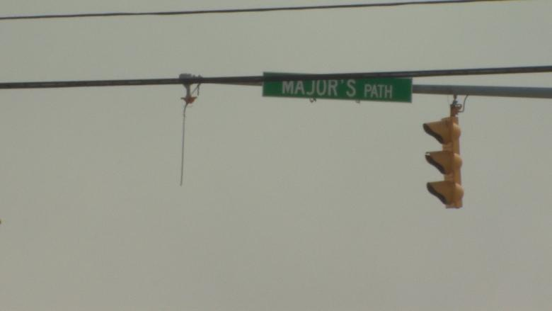 To hang or affix? St. John's defends how it installs traffic lights