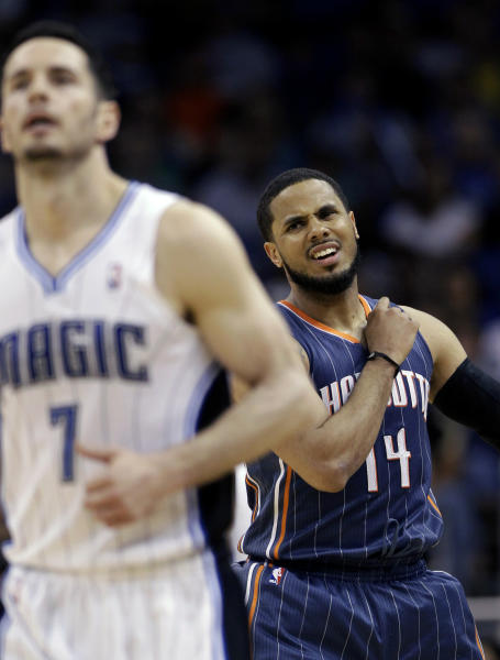 Charlotte Bobcats' D.J. Augustin (14) reacts after missing a shot as he chases Orlando Magic's J.J. Redick (7) downcourt during the second half of an NBA basketball game, Wednesday, April 25, 2012, in Orlando, Fla. Orlando won 102-95. (AP Photo/John Raoux)