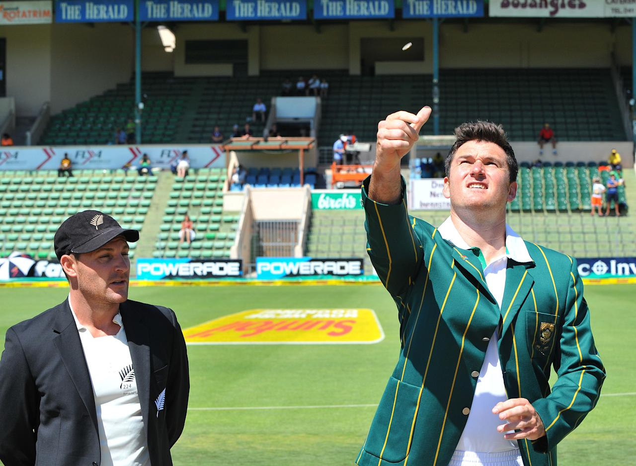 PORT ELIZABETH, SOUTH AFRICA - JANUARY 11:  Graeme Smith of South Africa tosses the coin with Brendon McCullum of New Zealand calling during day one of the second test match between South Africa and New Zealand at Axxess St Georges on January 11, 2013 in Port Elizabeth, South Africa. (Photo by Duif du Toit/Gallo Images/Getty Images)