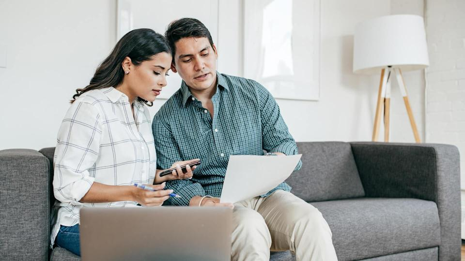 Couple looking on bank statements.