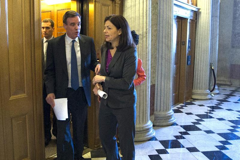 Sen. Kelly Ayotte, R-N.H., right, and Sen. Mark Warner, D-Va., arrive for a Senate vote on military sexual assault legislation on Capitol Hill on Monday, March 10, 2014, in Washington. (AP Photo/ Evan Vucci)