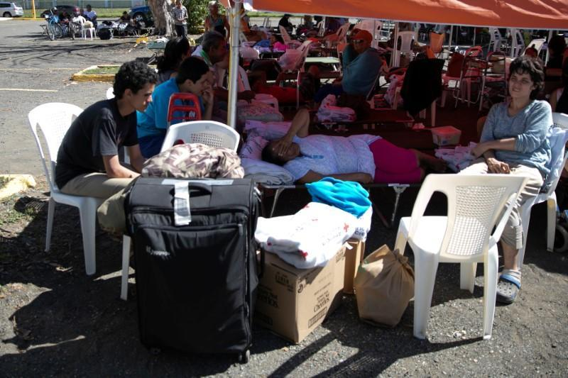 People rest at a temporary shelter camp in a sports complex, after an earthquake in Guanica