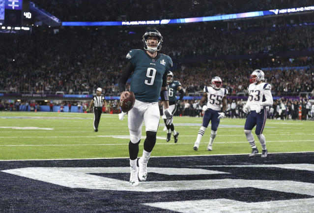 "<a class=""link rapid-noclick-resp"" href=""/nfl/teams/phi/"" data-ylk=""slk:Philadelphia Eagles"">Philadelphia Eagles</a> quarterback Nick Foles (9) catches a touchdown pass from tight end Trey Burton in the Super Bowl. (AP)"