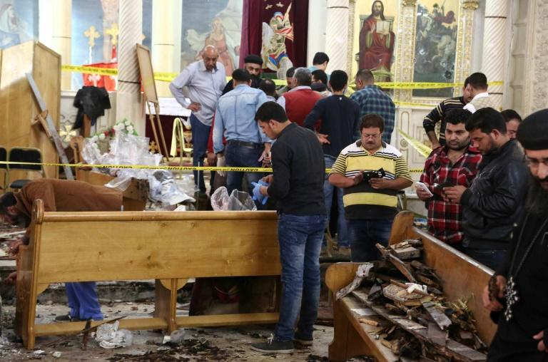 Forensics collecting evidence at the site of a bomb blast which struck worshippers gathering to celebrate Palm Sunday at the Mar Girgis Coptic Church in the Nile Delta City of Tanta, 120 kilometres  north of Cairo, on April 9, 2017