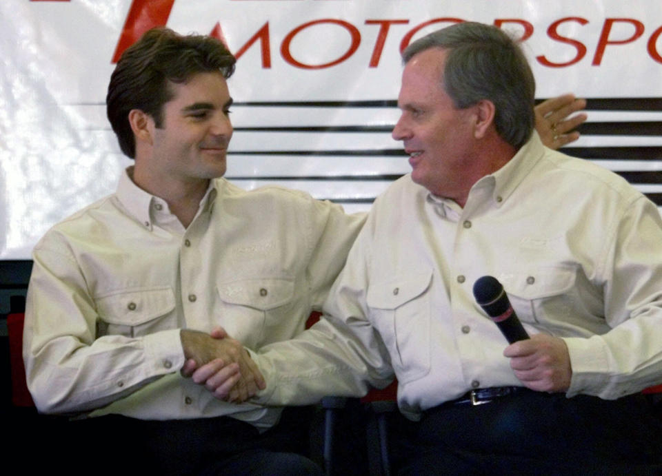 FILE - Driver Jeff Gordon, left, shakes hands with team owner Rick Hendrick during a news conference to announce a long-erm agreement in Harrisburg, N.C., in this Wednesday Oct. 6, 1999, file photo. Jeff Gordon will leave the Fox Sports booth for a daily role at Hendrick Motorsports as vice chairman ranked second only to majority owner Rick Hendrick. The new job positions the four-time champion and Hall of Famer to eventually succeed Hendrick at the top of NASCAR's winningest organization. (AP Photo/Chuck Burton, File)