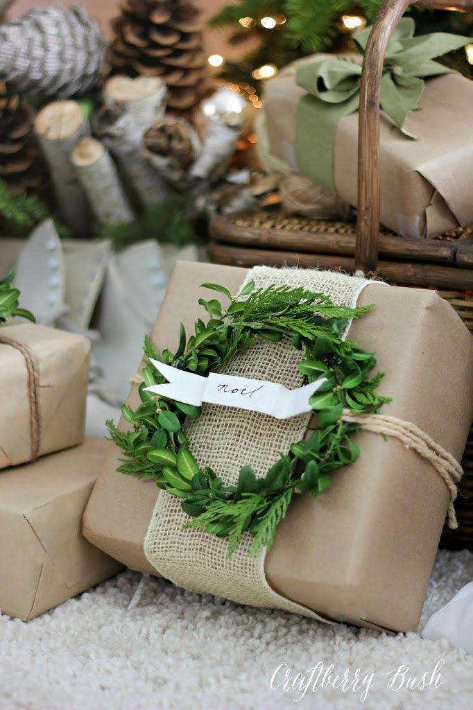 """<p>Fashion a miniature wreath out of greenery or fresh herbs, then add a little cardstock banner for the recipient's name or a holiday greeting. </p><p>Get the tutorial at <a href=""""https://www.craftberrybush.com/2014/12/craft-paper-and-boxwood-wreath-gift-wrap.html"""" rel=""""nofollow noopener"""" target=""""_blank"""" data-ylk=""""slk:Craftberry Bush"""" class=""""link rapid-noclick-resp"""">Craftberry Bush</a>. </p><p><a class=""""link rapid-noclick-resp"""" href=""""https://www.amazon.com/Neenah-Bright-Cardstock-Sheets-90905/dp/B003A2I5T8/?tag=syn-yahoo-20&ascsubtag=%5Bartid%7C10072.g.34015639%5Bsrc%7Cyahoo-us"""" rel=""""nofollow noopener"""" target=""""_blank"""" data-ylk=""""slk:SHOP WHITE CARDSTOCK"""">SHOP WHITE CARDSTOCK</a></p>"""