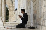 A man takes part in the last Friday prayers of the Muslim holy month of Ramadan at the Dome of the Rock Mosque in the Al Aqsa Mosque compound in the Old City of Jerusalem, Jerusalem, Friday, May 7, 2021. (AP Photo/Mahmoud Illean)
