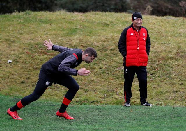 Rugby Union - England Training - Pennyhill Park, Bagshot, Britain - February 20, 2018 England's Jonny May watched by head coach Eddie Jones during training Action Images via Reuters/Paul Childs