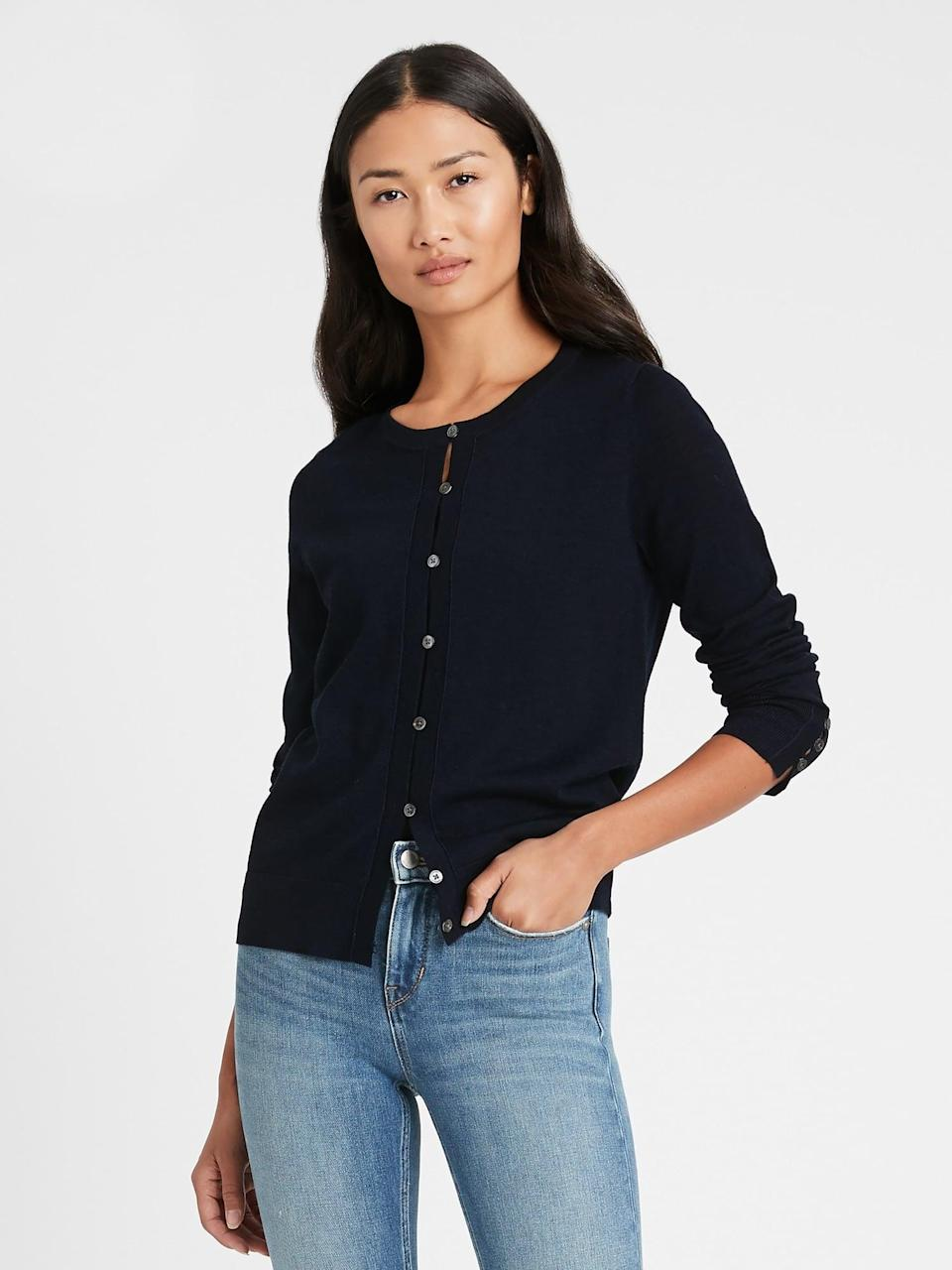 <p>This <span>Banana Republic Merino Cardigan Sweater in Responsible Wool in Navy</span> ($23, originally $80) is another stylish option. Wear buttoned up with a tank underneath and tucked in for a cool modern henley style look.</p>